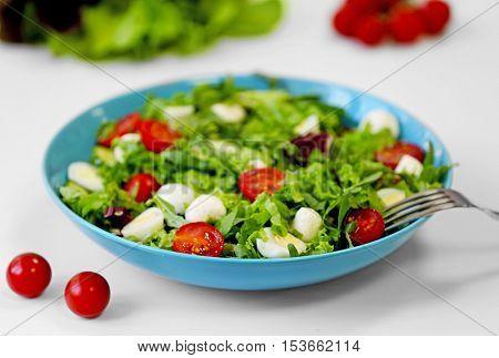 Fresh delicious salad on white background, closeup