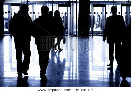 Business people walking. Big hall at Moscow exhibition. Specially with high contrast.