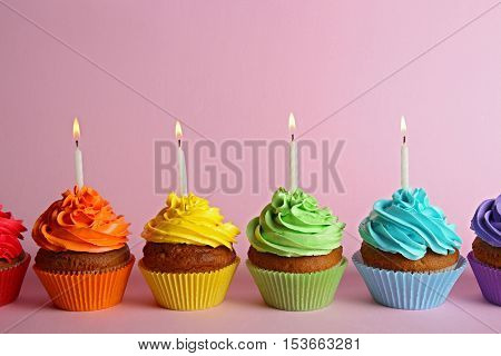 Fresh tasty cupcakes on lilac background