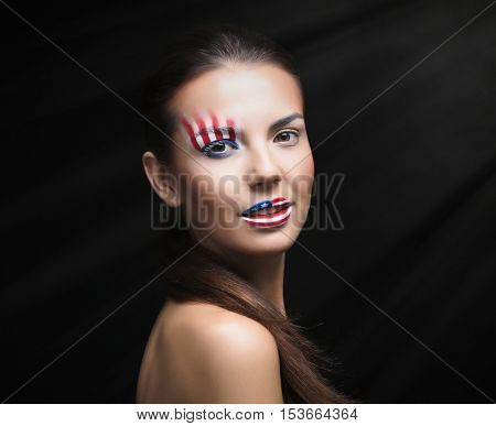 Girl with USA makeup on black background