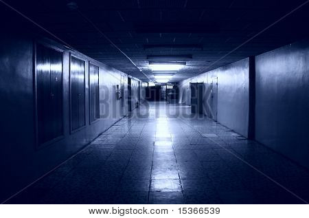 Dark corridor in office building. Blue tint.