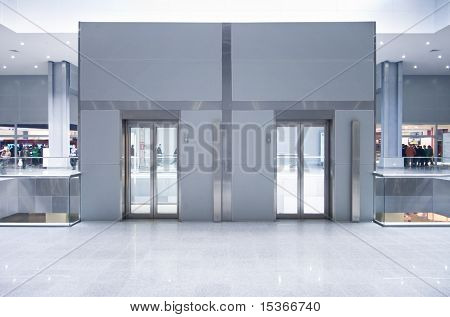 Lift doors on a top storey in a business center.
