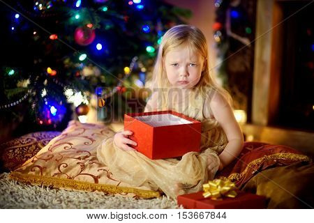 Cute Little Girl Is Unhappy With Her Christmas Gift