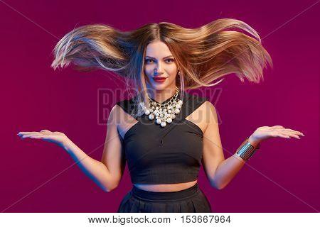 Beautiful glamourous woman with long brown flying hair, studio shot