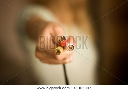 Woman hand with plugs. Low DOF.