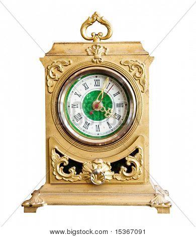 Antique goldish clock. Isolated on white.