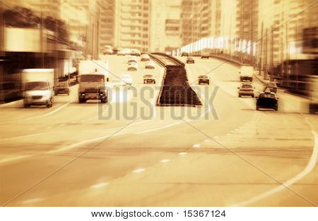 Big road with cars. Red tint, high contrast and motion blur to rise speed.