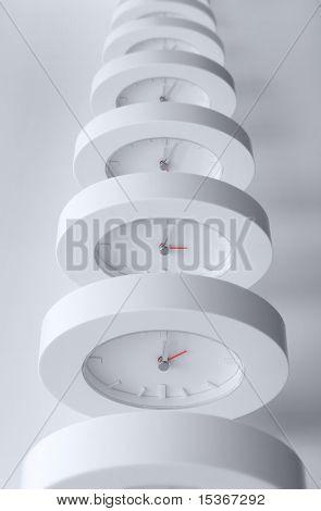 Endless line of equal clocks.