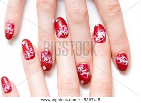 Woman fingers with decorated nails. Isolated on white.