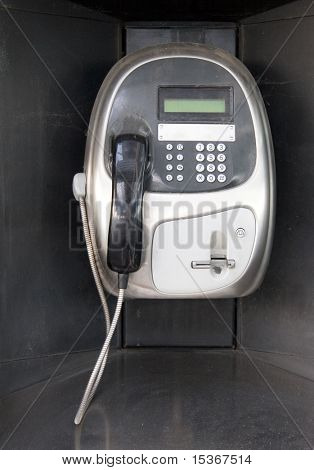 Public modern telephone front view.