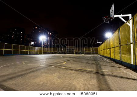 Sport basketball court at night.