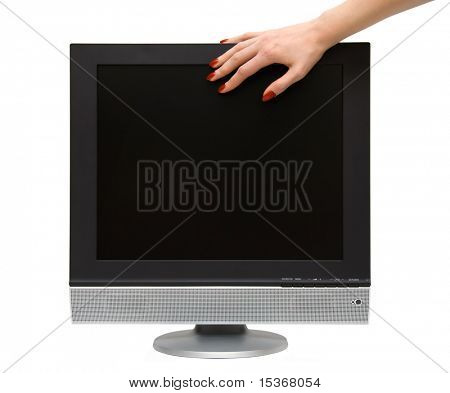 Woman hand on lcd-tv screen. Isolated on white.