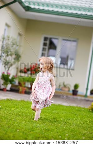 Adorable Little Girl In A Yard