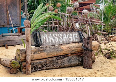 Wooden information sign about Thai massage at the Maenam beach Koh Samui Thailand