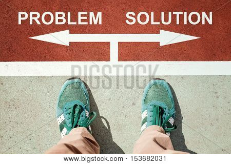 Problem or solution concept with legs from above standing on signs