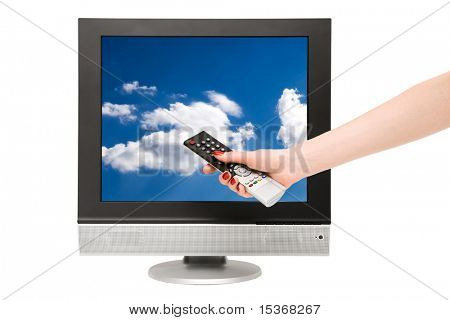 Woman hand and tv screen with blue sky. Isolated on white.