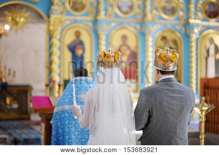 Bride and groom in an orthodox wedding ceremony in church