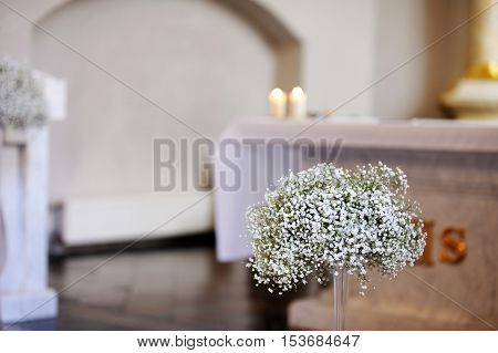 Beautiful flower decoration in a church during wedding ceremony