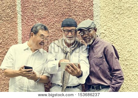 Group Of Senior Retirement Using Digital Devices Concept