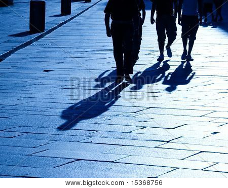 Four walking people shadows. Blue tint.