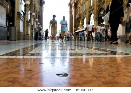 People walking in a trade center Milan Italy. Focus on a ground.