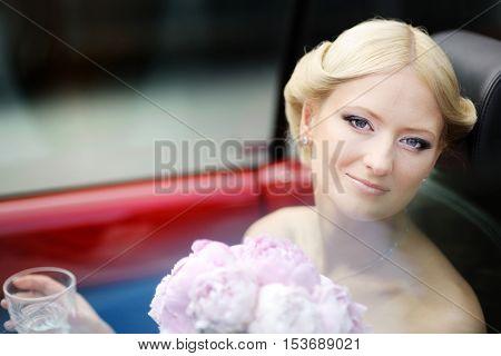 Bride Portrait In A Car