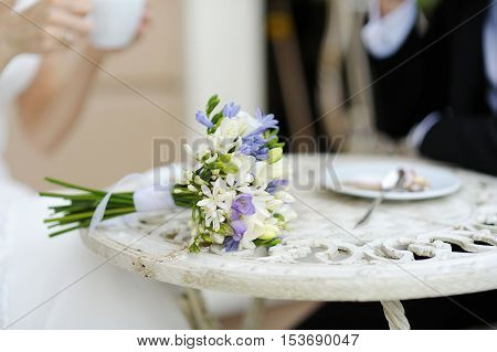 Beautiful wedding bouquet on a white table