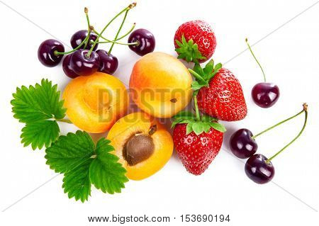 Fresh berries and fruits in still life. Top view with green leaves strawberry. Apricot. Cherry isolated on white background