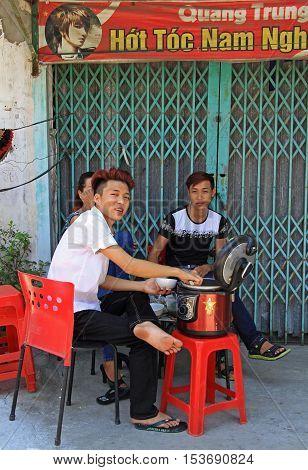 Vinh, Vietnam - May 30, 2015: people are eating outdoor in Vinh Vietnam