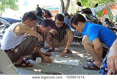Vinh, Vietnam - May 30, 2015: people are playing janggi outdoor in Vinh, Vietnam