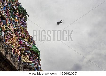 Detais of indian Kapaleeswarar temple , Chennai, India and a plane