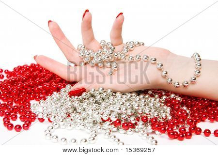 Woman hand with red and silver glassbeads.