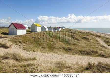 Beach, dunes and beach huts at Gouville, Normandy, France
