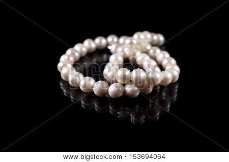 String of pearls isolated on black background