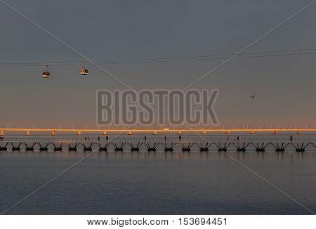 Cablecar line and brıdges over a bay in Lisbon