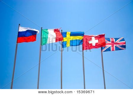 Five national flags on blue sky.