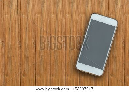 The empty screen phone on wood background.