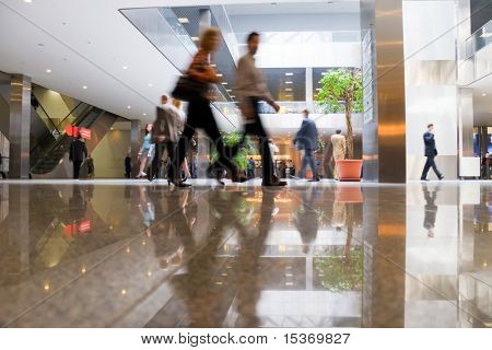Walking people in modern business center.