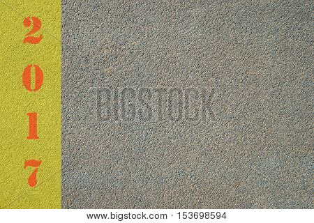 Start new year with red number 2017 written on yellow line on road with copy space for text new year plan target.
