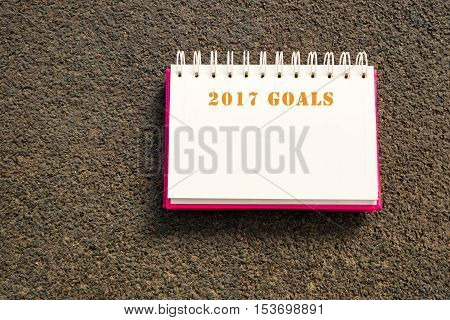 Book write 2017 goals on road background. Concept of set target goal for new year 2017.