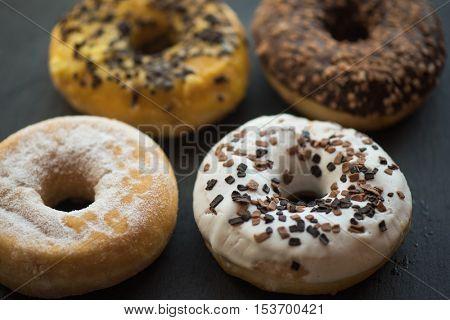 Set of donuts on black background