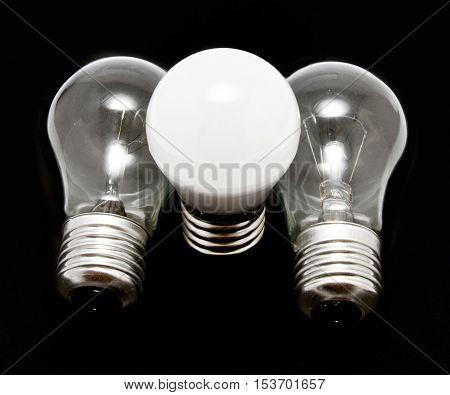 glow and led lamps energy efficiency concept