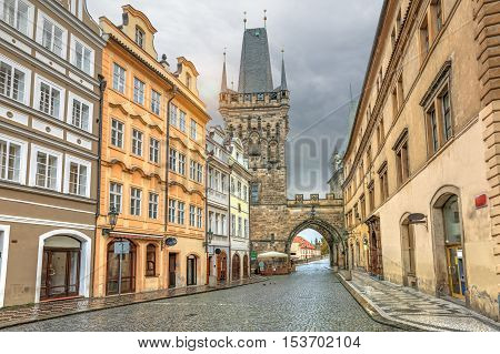 Malostranska tower and old buildings on Mostecka street in Pargue Czech Republic