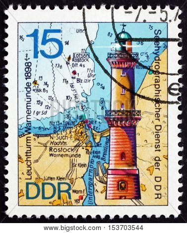 GERMANY - CIRCA 1974: a stamp printed in Germany shows Warnemunde 1898 Lighthouse and Nautical Chart circa 1974