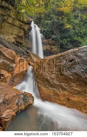 Douglas Falls a plunging waterfall on the North Fork of West Virginia's Blackwater River is distinguished by its colorful red rocks.