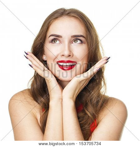 Surprised happy young woman looking sideways in excitement. Isolated over white background