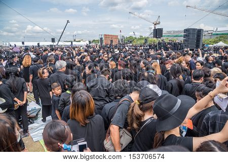 Bangkok Thailand - October 22 2016 : Thai people come for singing the anthem of His Majesty King Bhumibol at Sanam Luang in front of the Royal Palace to pay respect for the king in Bangkok Thailand.