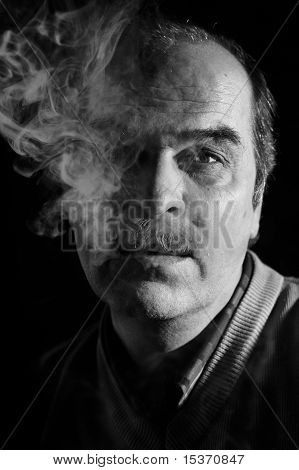 Portrait Of Man In Cigarette Smoke