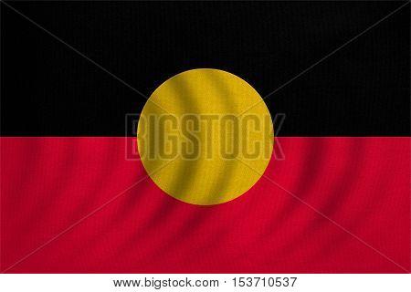 Australian Aboriginal official flag. Commonwealth of Australia patriotic symbol banner element background. Australian Aboriginal flag wavy detailed fabric texture accurate size colors illustration