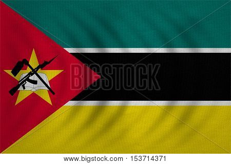 Mozambican national official flag. African patriotic symbol banner element background. Correct colors. Flag of Mozambique wavy with real detailed fabric texture accurate size illustration